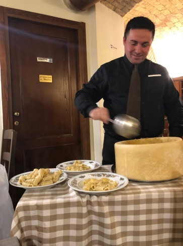 Pasta mixed fresh in a wheel of Parmigiano Reggianogiano